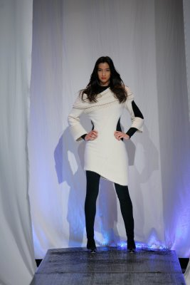 Model wearing white strikes a pose
