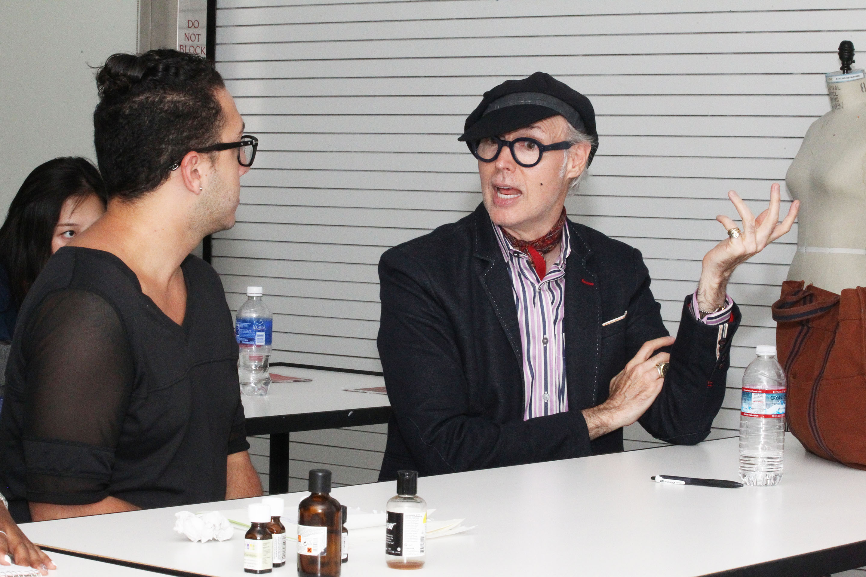 Dandy Patrick McDonald gives feedback to fashion merchandising students on their group project. Photo by Bob Toy.