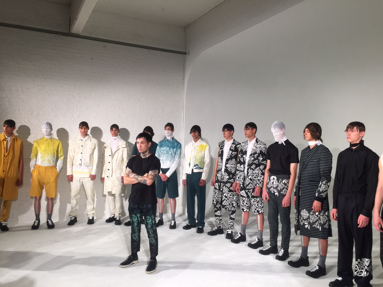 School of Fashion Alumna Kenneth Ning with his models; Image via Facebook.com