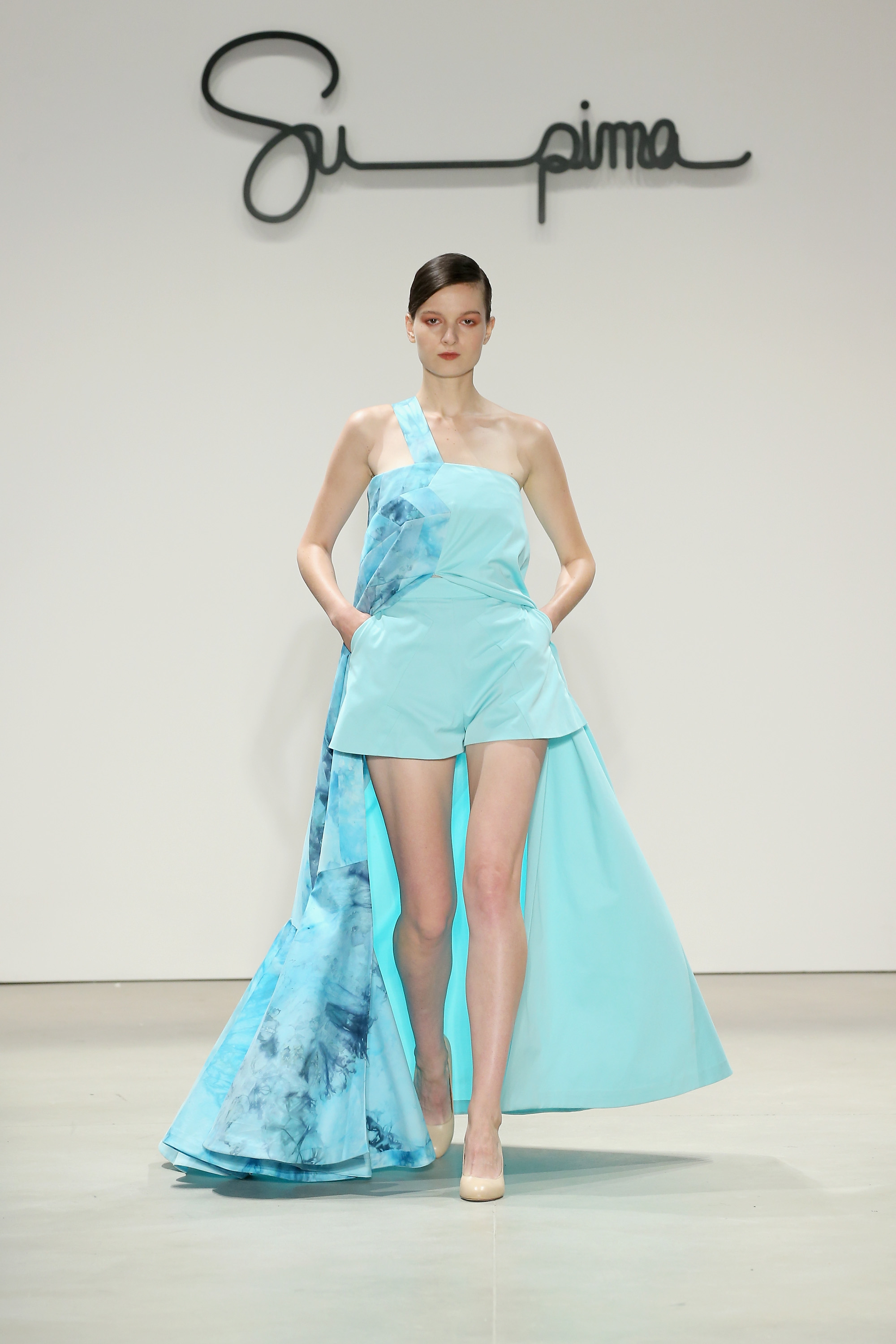 Twill floor length, tent shaped dress, ice dyed in hues of blue with single shoulder strap, Courtesy of Supima
