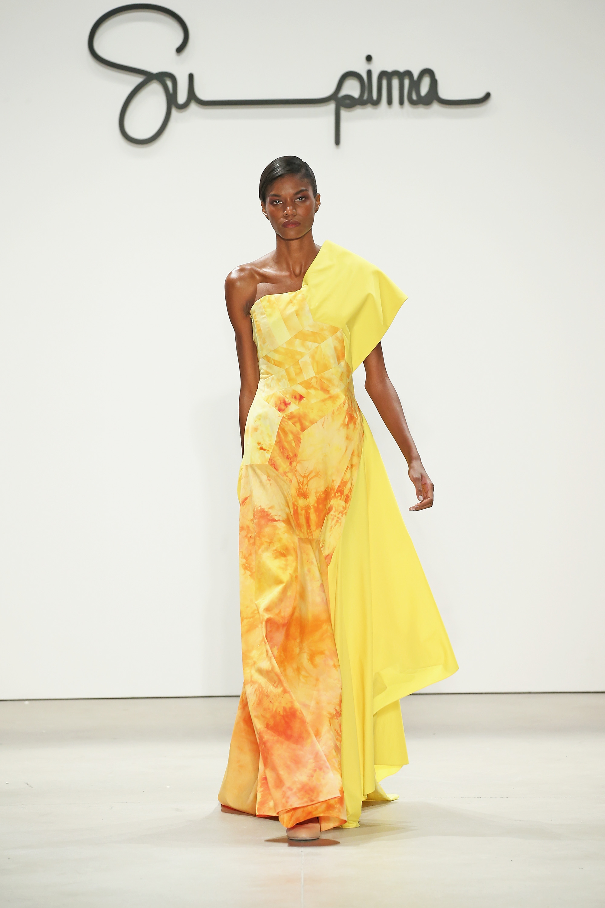Shirting dress, ice dyed in fiery oranges and yellow with asymmetrical hemline, Courtesy of Supima
