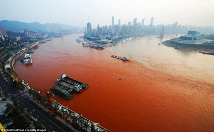Yangtze River in Chongqing, China turns red from textile waste pollution. Photo courtesy of ChinaFotoPress via Getty Images.