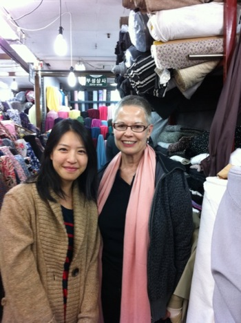 Jungah and Camilla in a sea of fabric