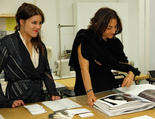 Nathalie Rykiel (right) looks at the work by BFA Fashion and Knitwear major Jannika Lilja.