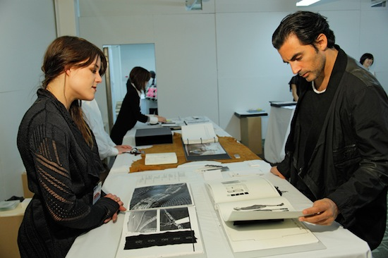 Yigal Azrouel (right) looks at Jannika Lilja work.