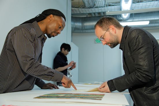William West (left) talks to Andrew Buckler at the Spring Portfolio Review. (Photo credit: Randy Brooke)