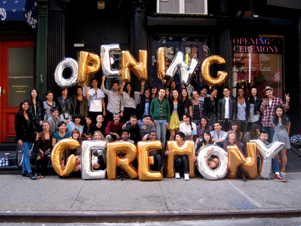 Picture of Opening Ceremony standing in front of storefront