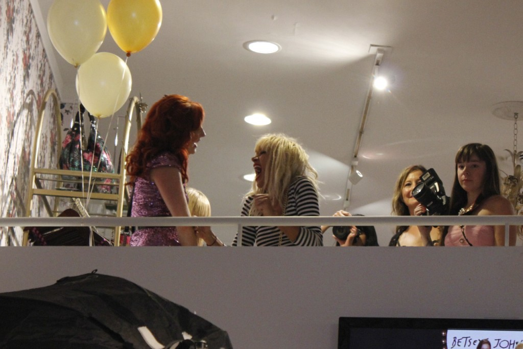 Betsey chatting with an employee upstairs