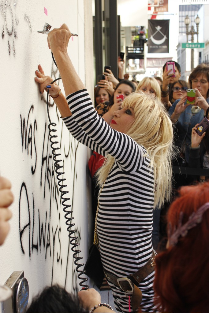 Betsey working on her mural