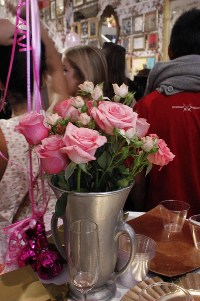 A table of Champagne and Pink Roses