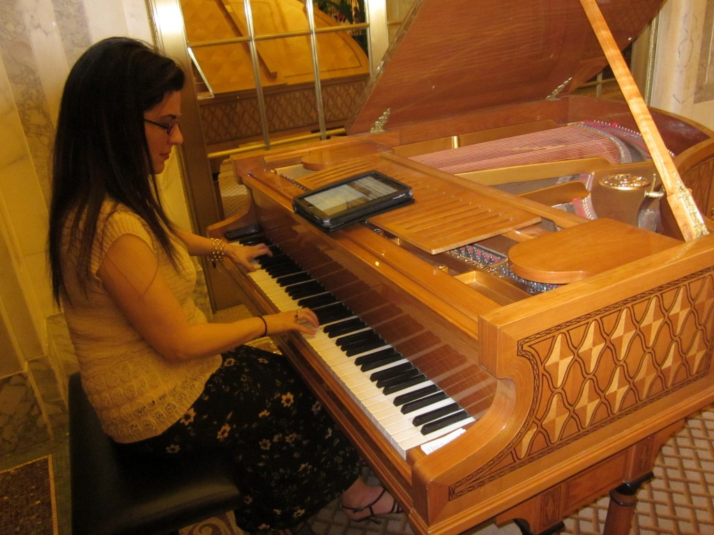 The pianist at The Plaza plays music from her Kindle