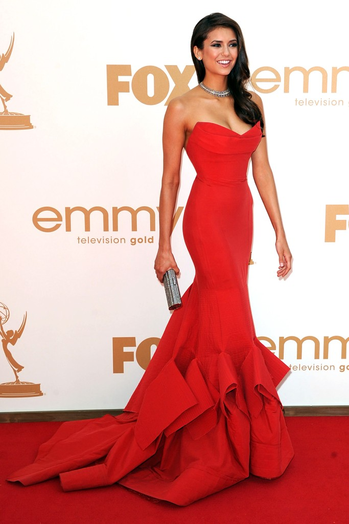 Nina Dobrev choose a classic red carpet look with this red strapless Donna Karan gown and Neil Lane jewels