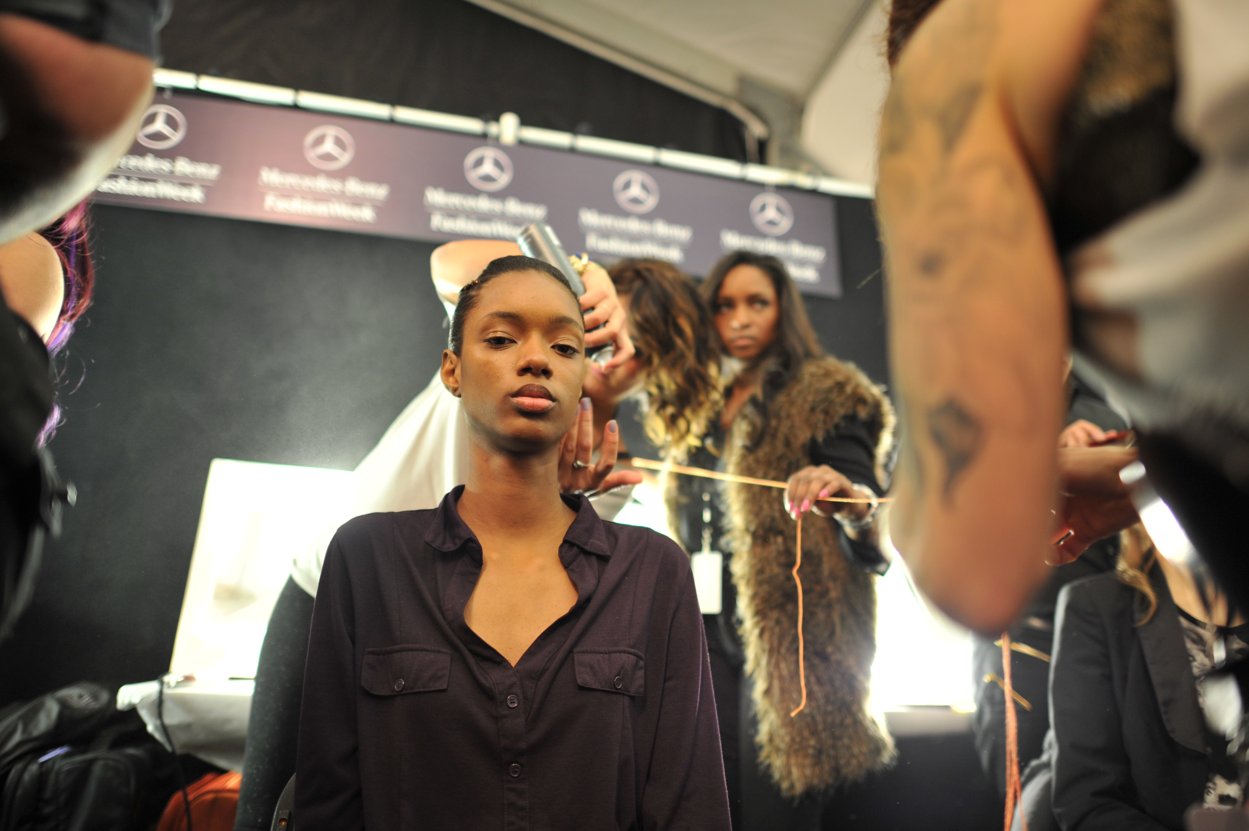 A model getting her hair done