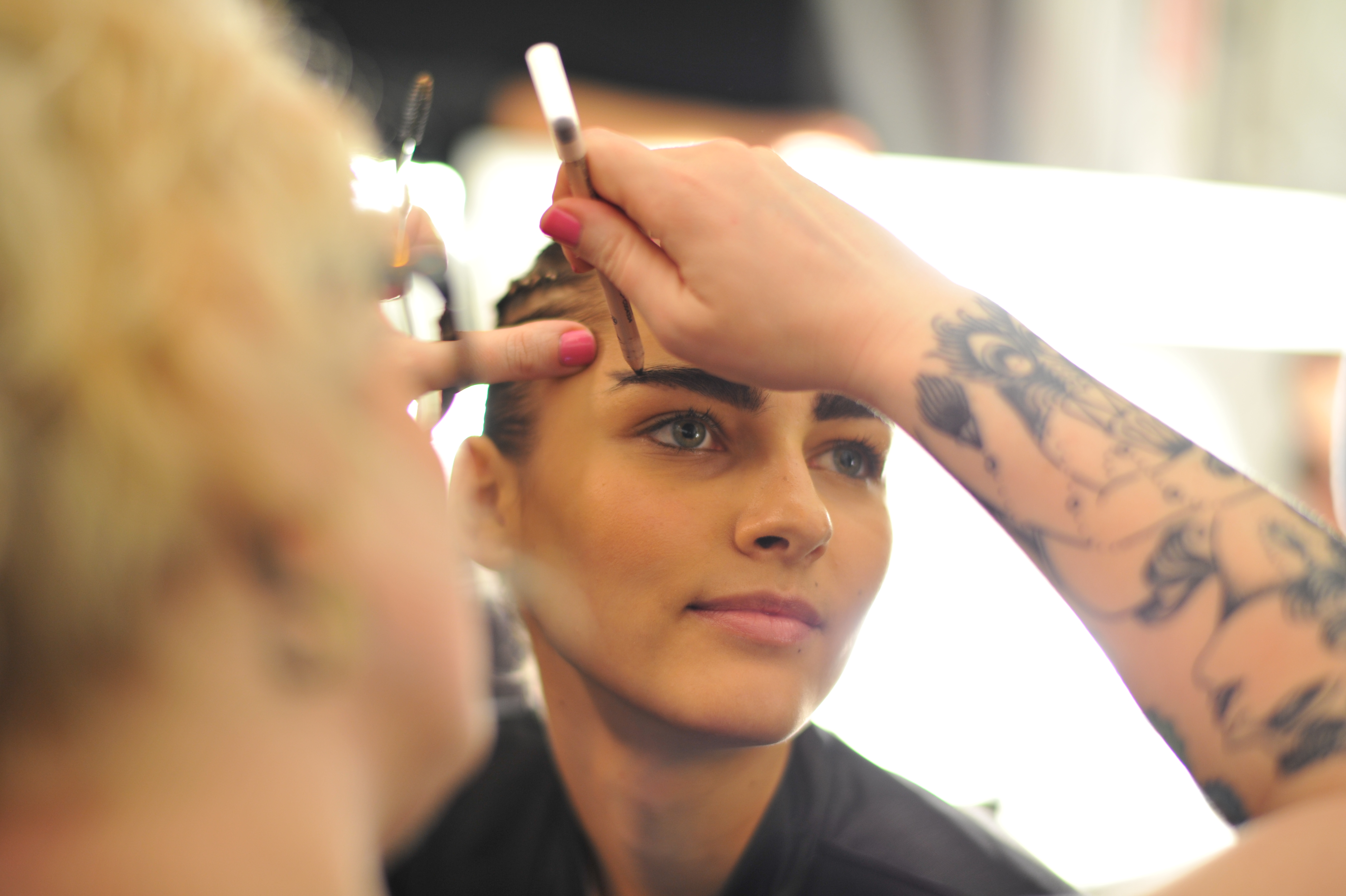 A model getting her makeup done.