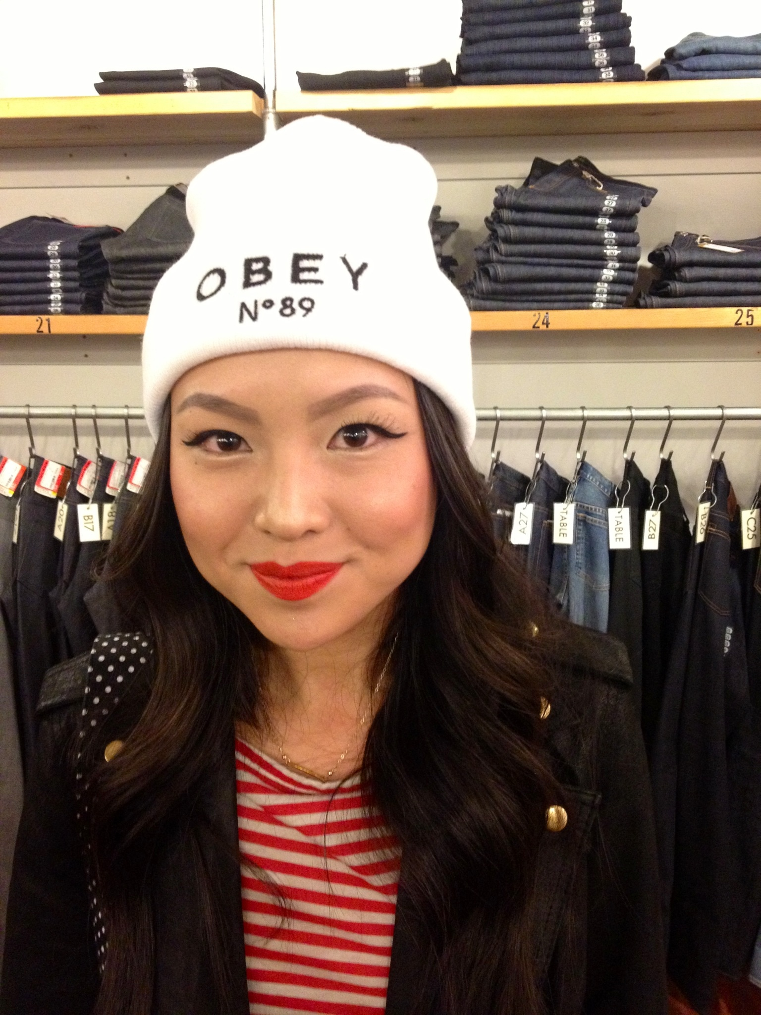 A guest sporting an OBEY beanie at the event.