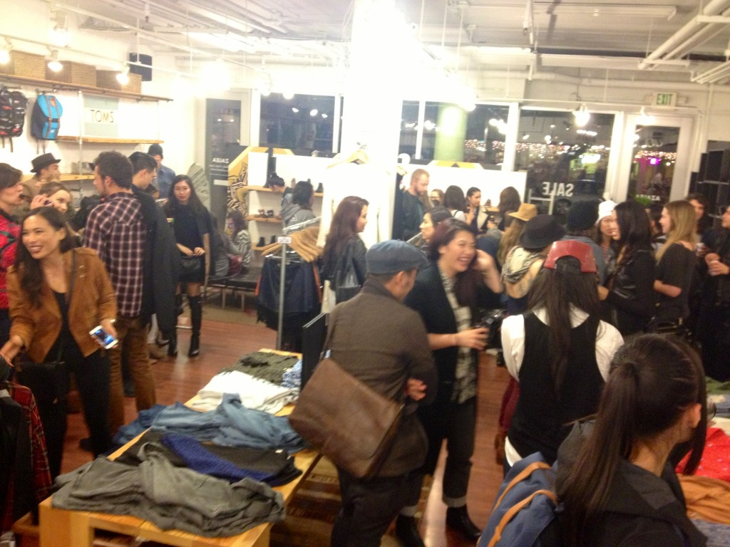 Guests mingling and shopping.
