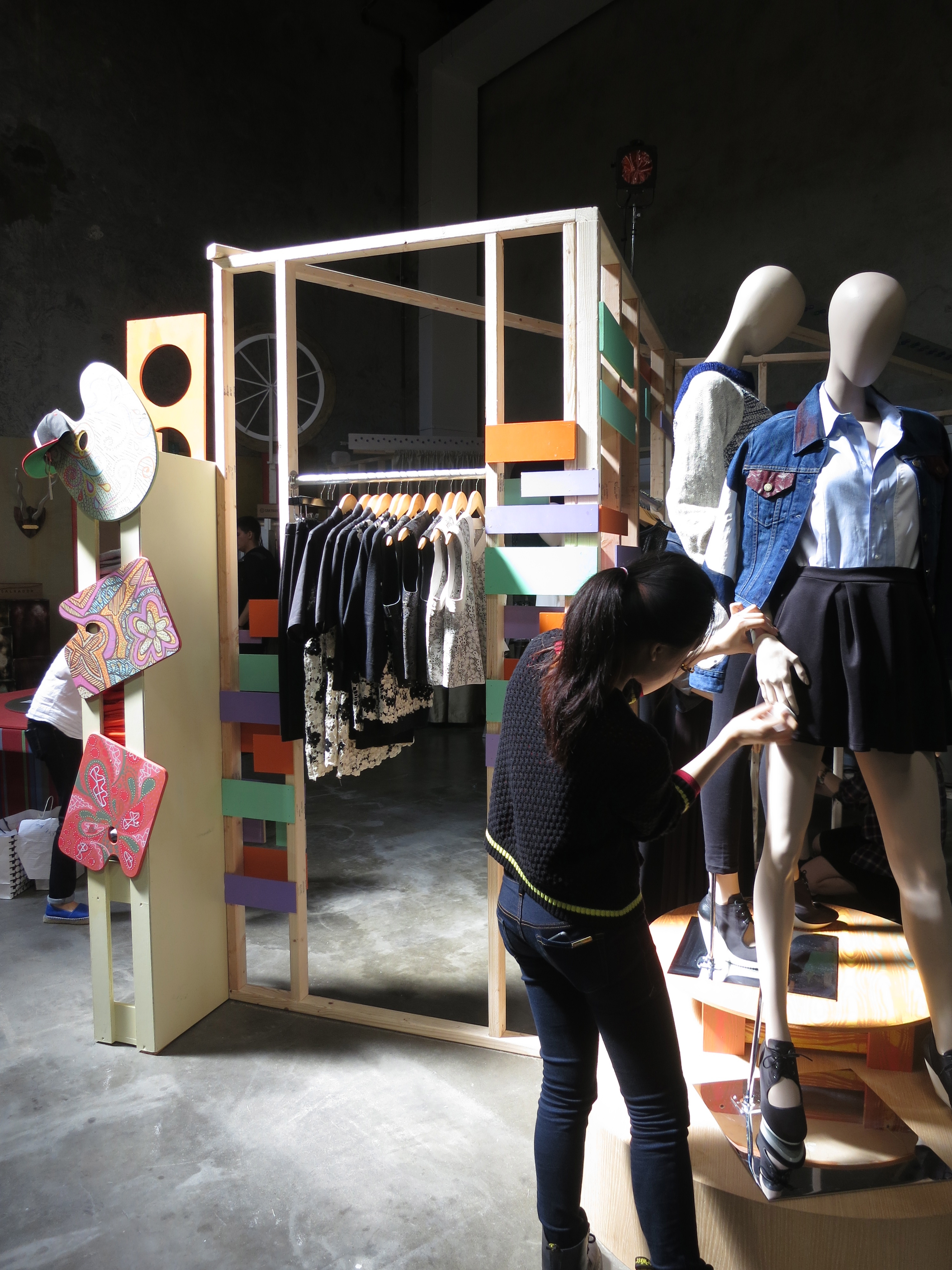 A Fashion Merchandising student puts the final touches on a display before the opening. Photo by Martin Zanfardino
