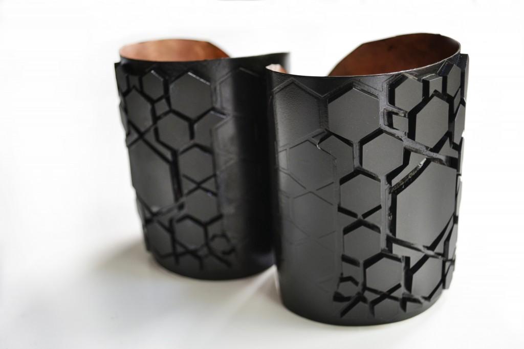 black and black bicep cuffs