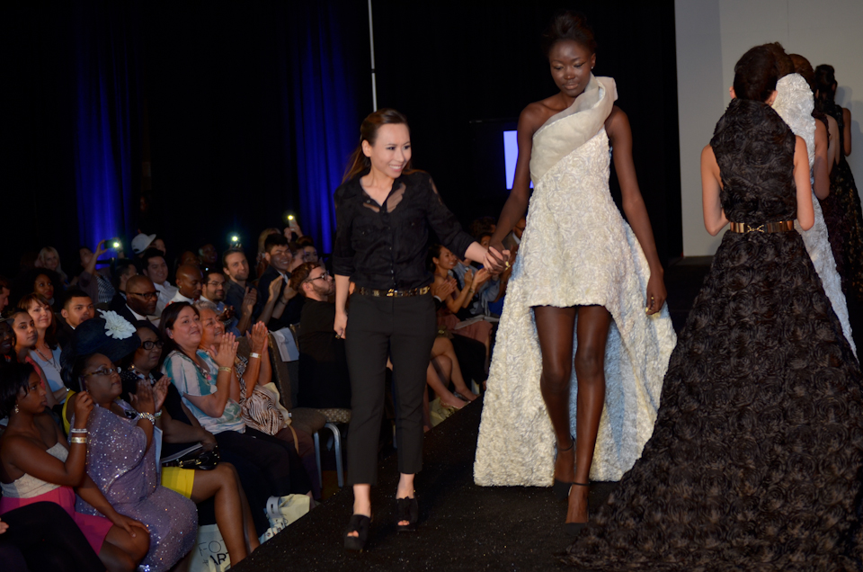 Cindy Quach walking with her finale model to end the show.