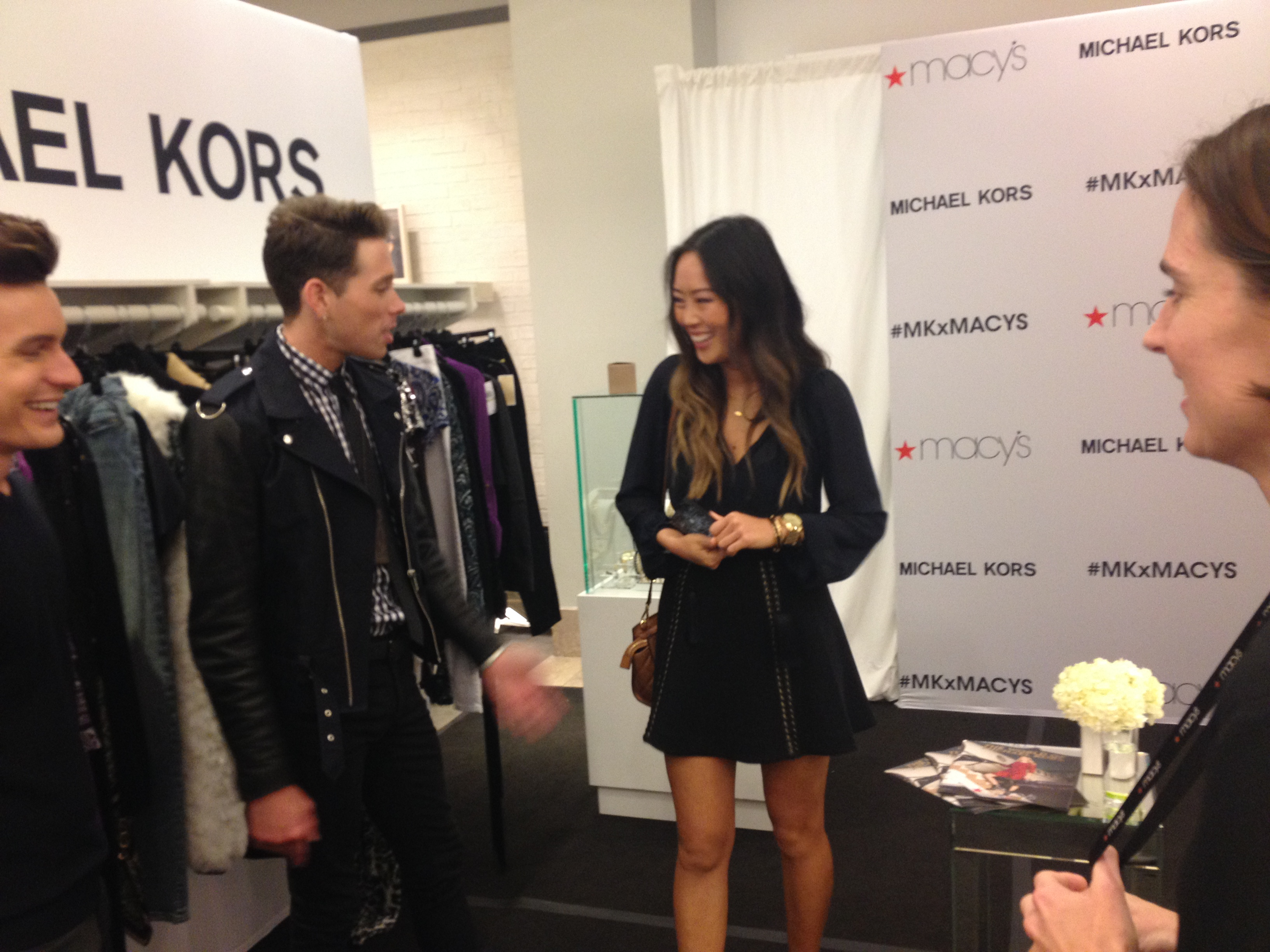 Some of team Michael Kors chatting with Aimee Song following the event.