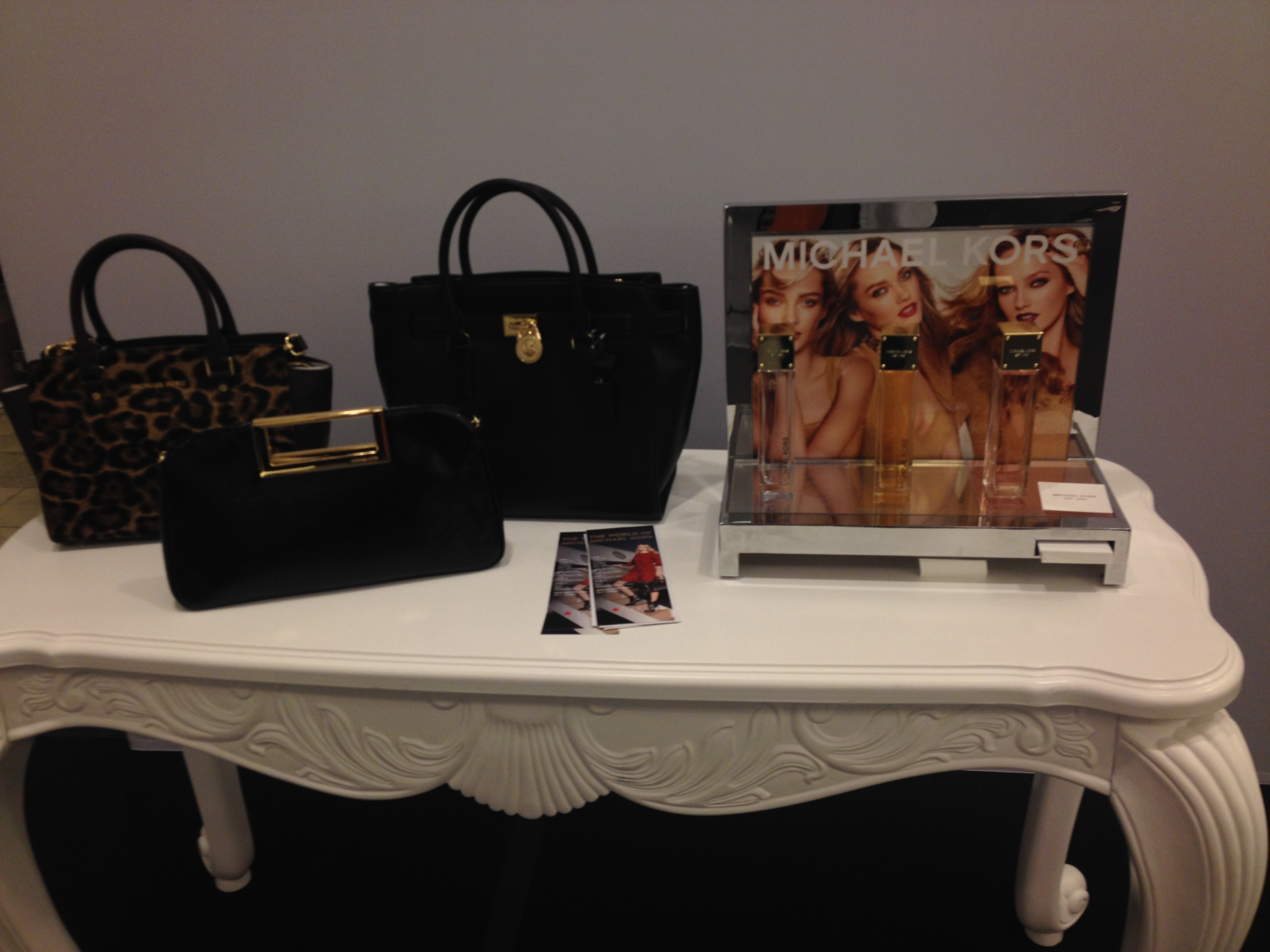 New accessory and fragrance merchandise from the new Fall Michael Kors line.