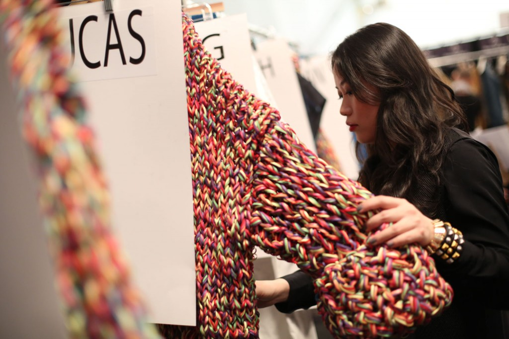 Stella Xingyu Hu, M.F.A. Fashion Design, checking out her collection.  Image: David Dooley
