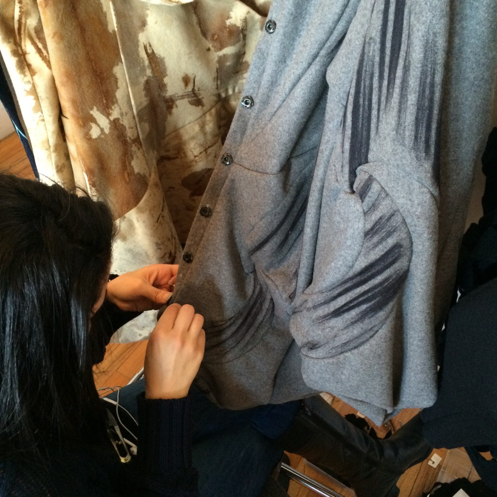 Farnaz Golnam, MFA Fashion Design, puts the finishing touches on a garment. Photo by Jeanette Peach.