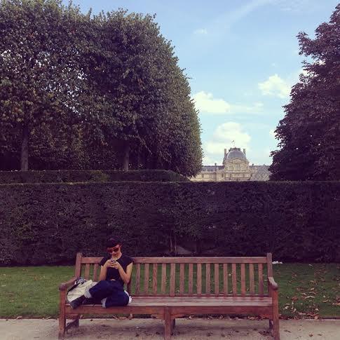 Yuko Okudaira relaxing on a bench in Paris.