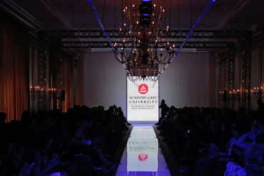 Photo of fashion runway with Academy of Art University logo