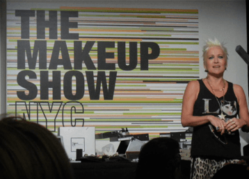 Charlie Green applying makeup
