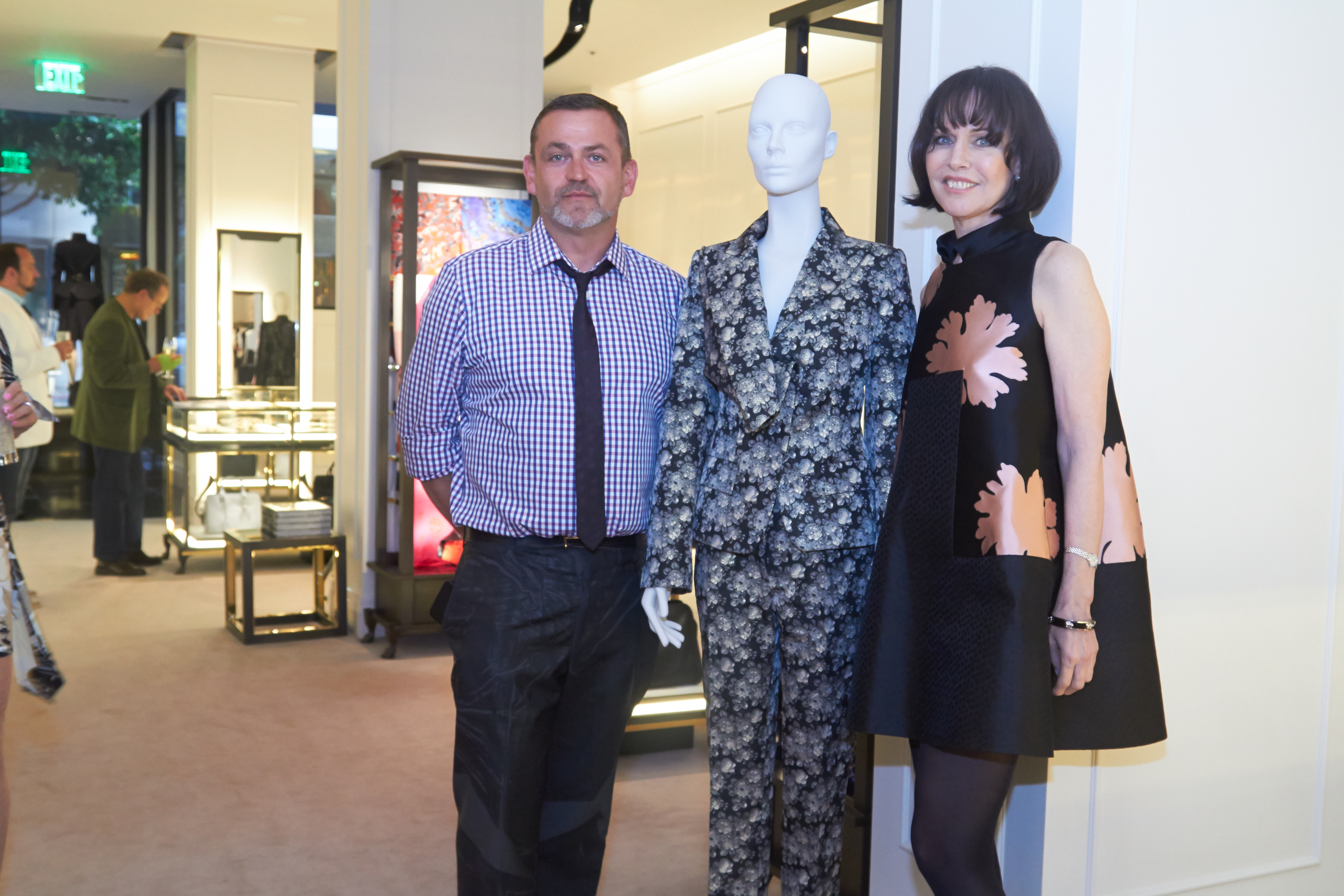 """Simon Ungless and Christine Suppes pose with a look from the 1996 McQueen """"Dante"""" collection."""