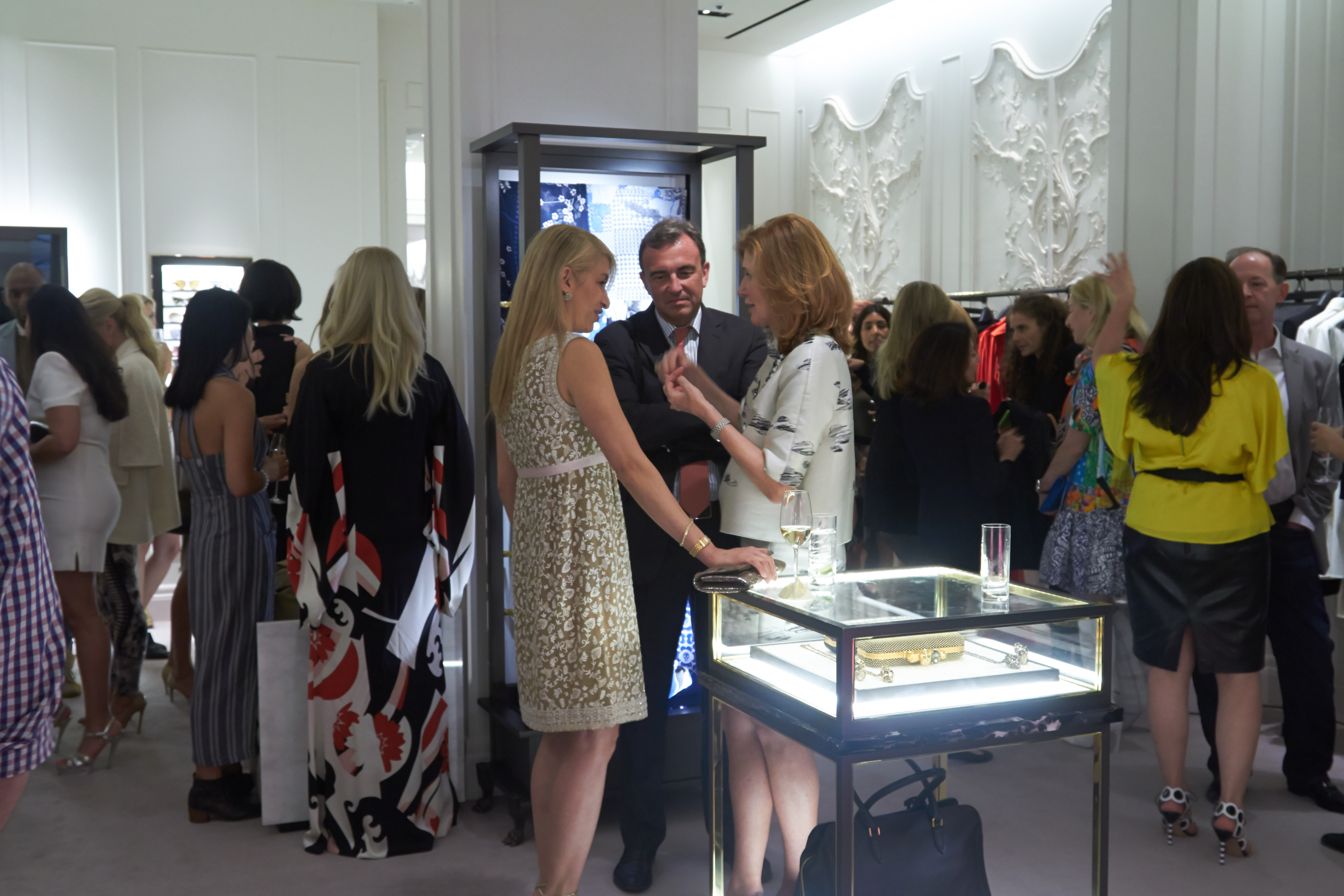 Guests chat and take in the stunning fashion on display during the reception.