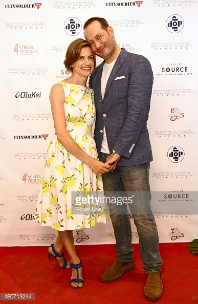 Designers Erik Nelson and Emily Cummings pose on the red carpet at the Edinger Apparel presentation during New York Fashion Week Men's SS16 at Rogue Space on July 14, 2015 in New York City