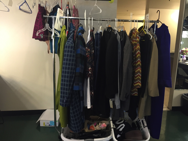 This is a rack from the women's dressing room where you can see some of the bold patterns on the coats.