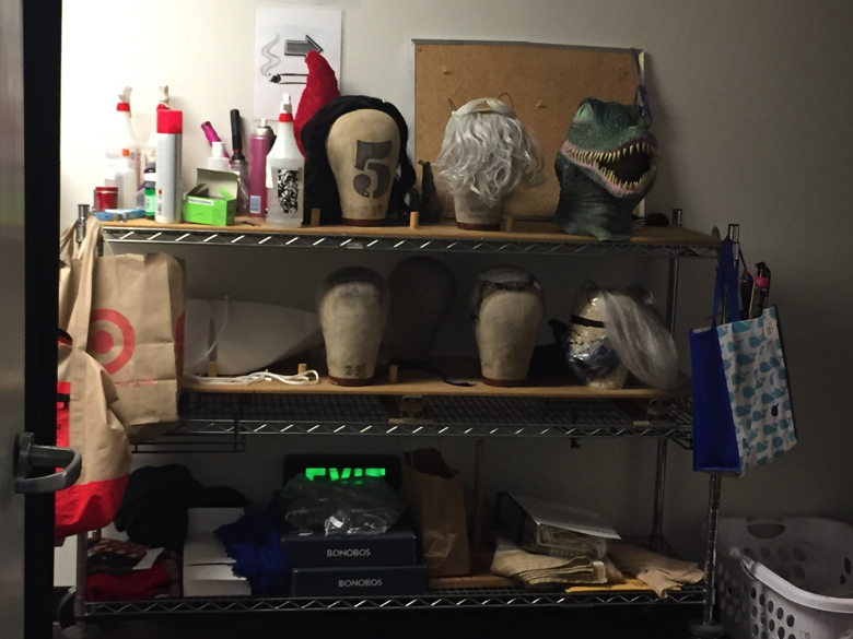 The slightly less glamorous wig rack complete with lizard head.