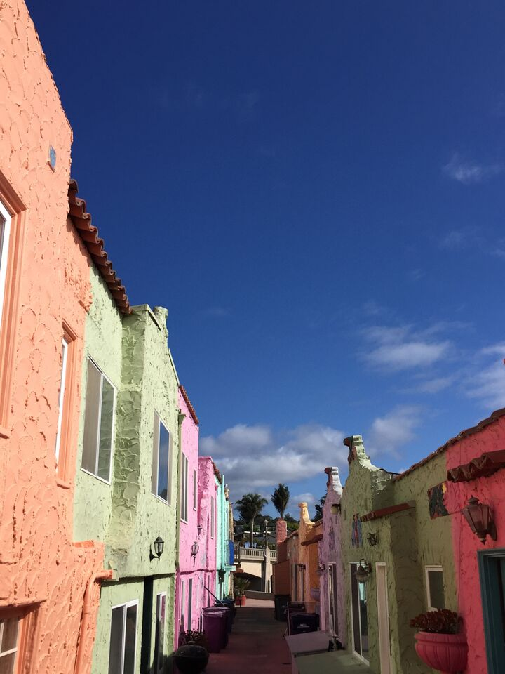 Alley with brightly colored pastel homes