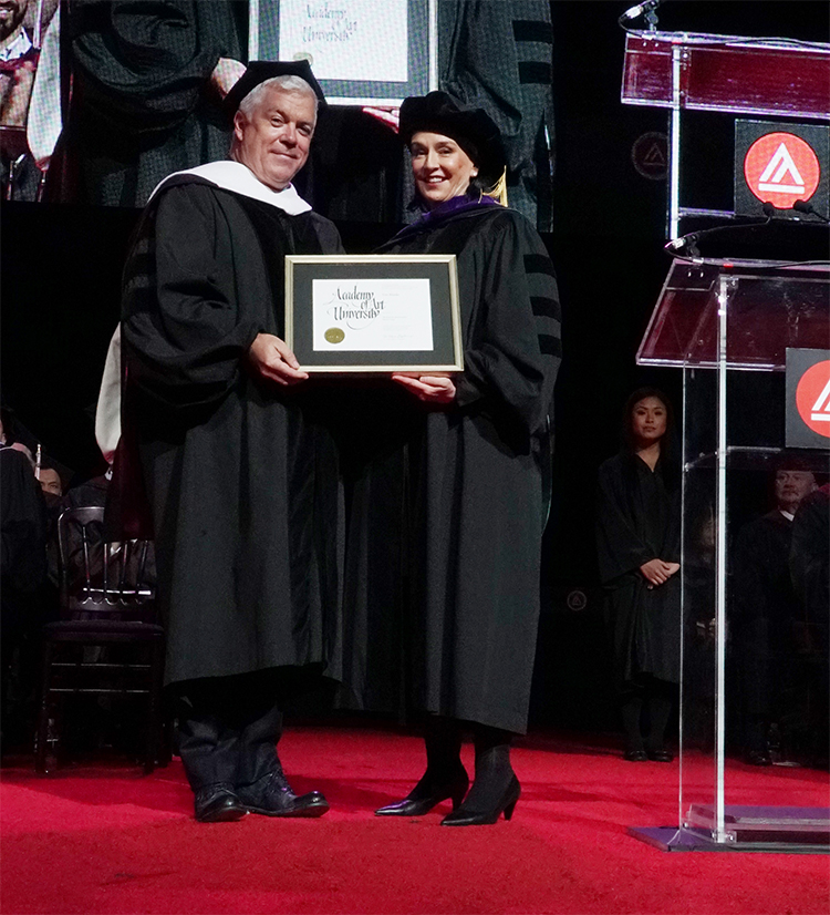 Tim Blanks receiving his honorary Doctorate diploma from President Elisa Stephens at Academy of Art University 2016 Commencement