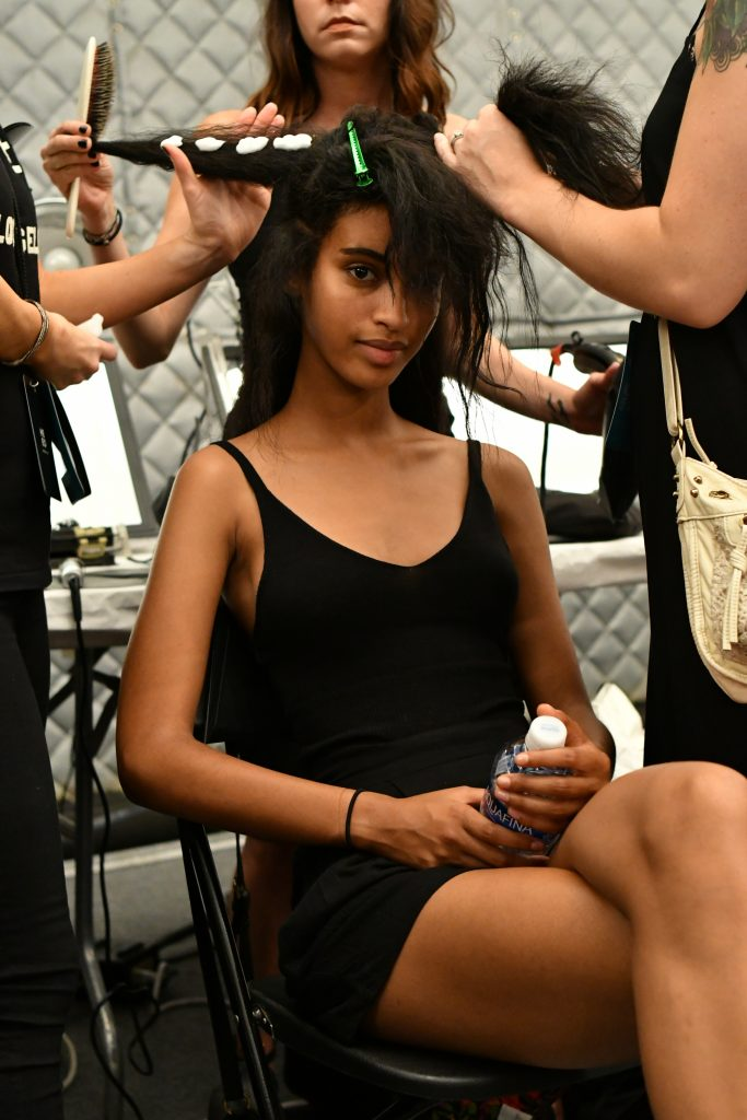 A model prepares at the Academy of Art University Spring 2017 Collections during New York Fashion Week at The Arc, Skylight at Moynihan Station on September 10, 2016 in New York City.