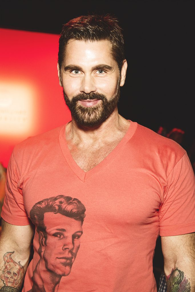 Pictured is Jack Mackenroth, a model and a fashion designer who competed in the fourth season of Project Runway. Image Source: Danielle Rueda